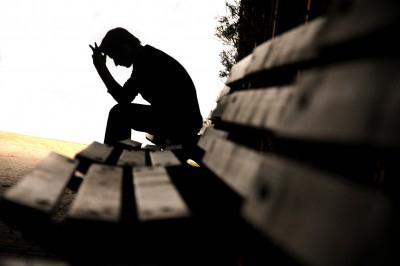 sad-man-silhouette-on-bench